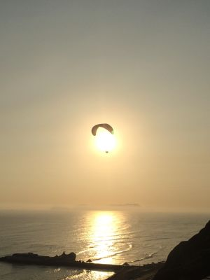 One of many parasailers near Larcomar shopping center