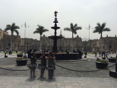 Three female police officers in the plaza